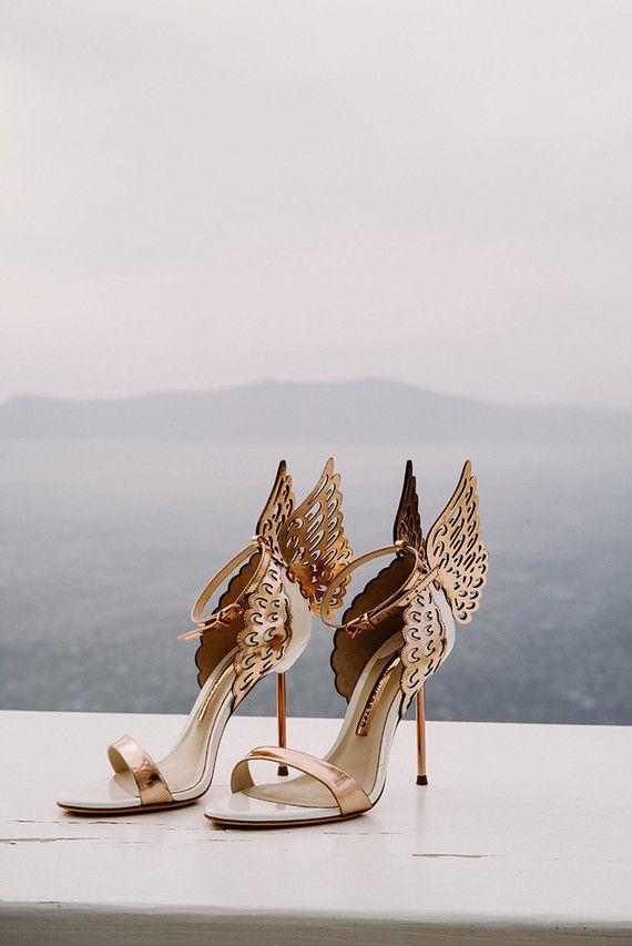 A pair of gold stilettos.