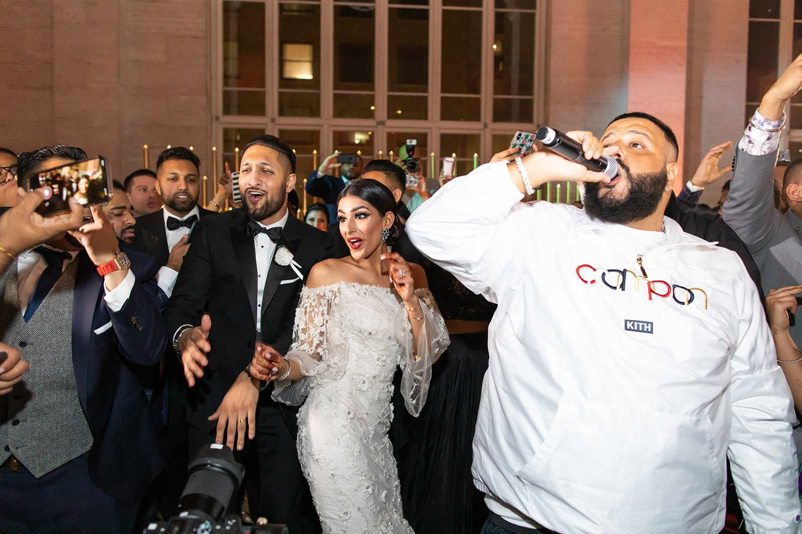 Bride and groom dancing with DJ Khaled