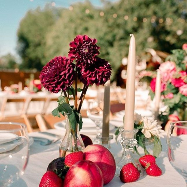 Simple wedding centerpieces with pink candles and fruit
