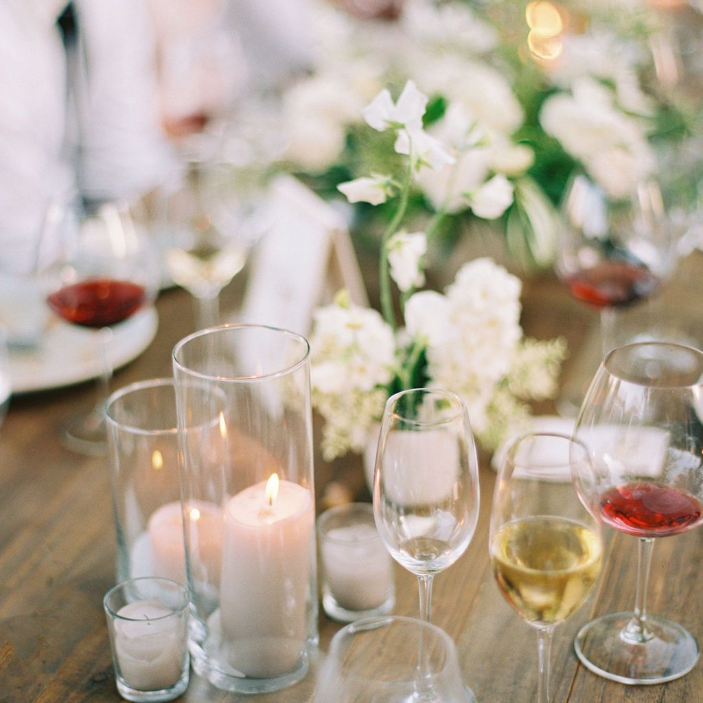 candles, flowers and wine glasses