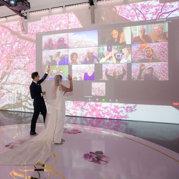 bride and groom waving to virtual guests