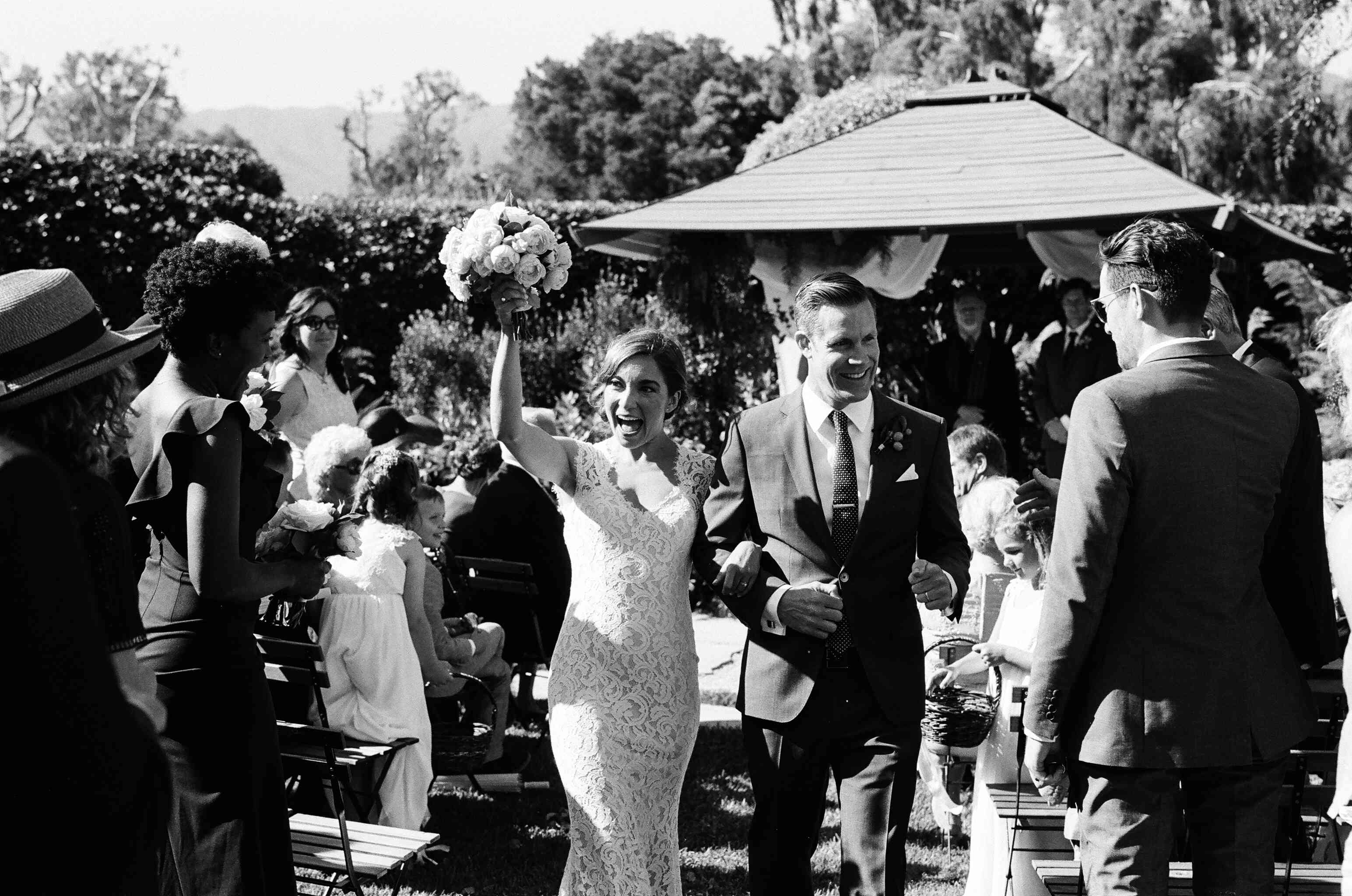 Bride and groom recessional black and white