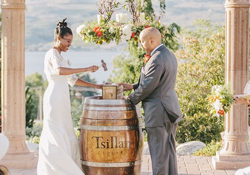 A couple during a wine box ceremony.