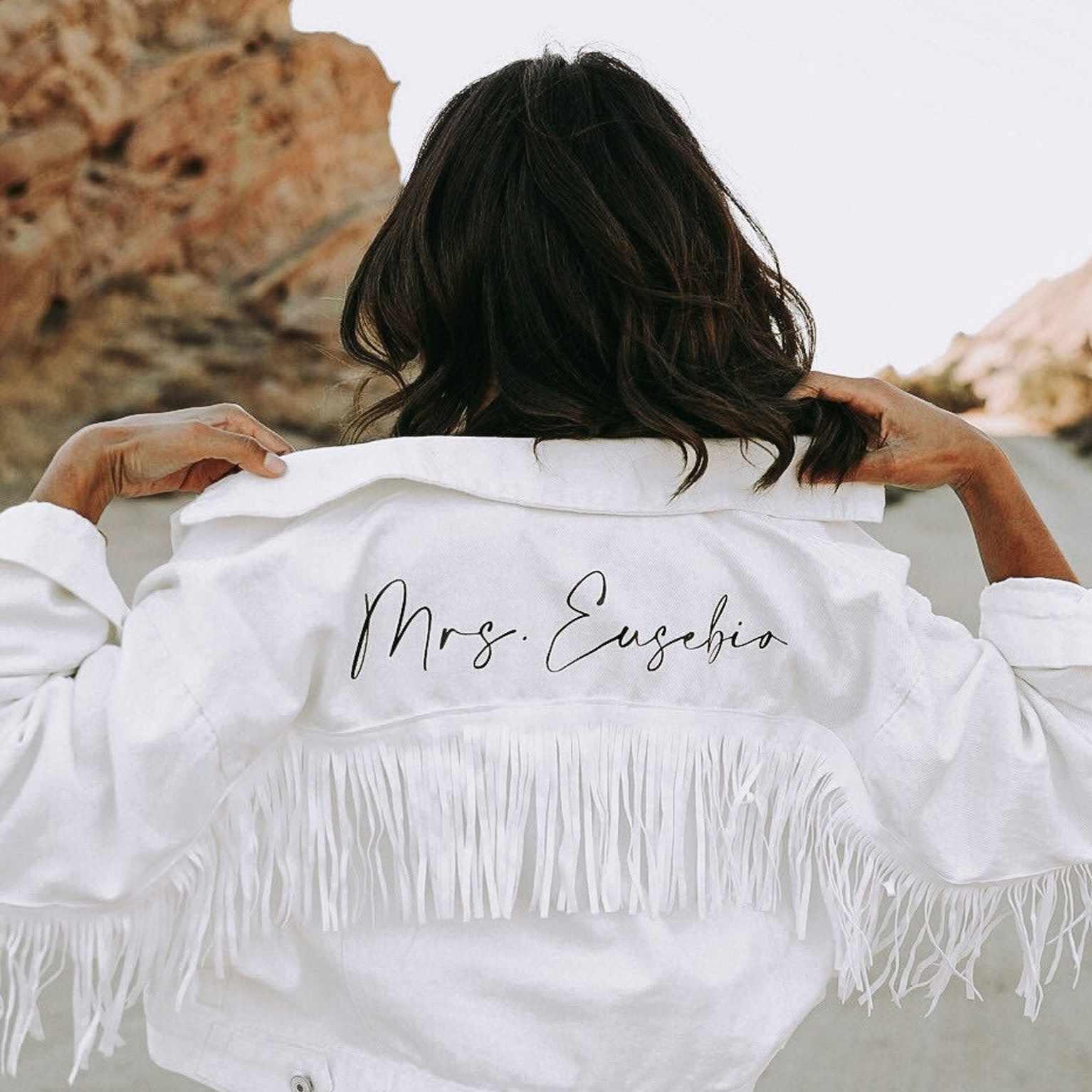white fringe jacket