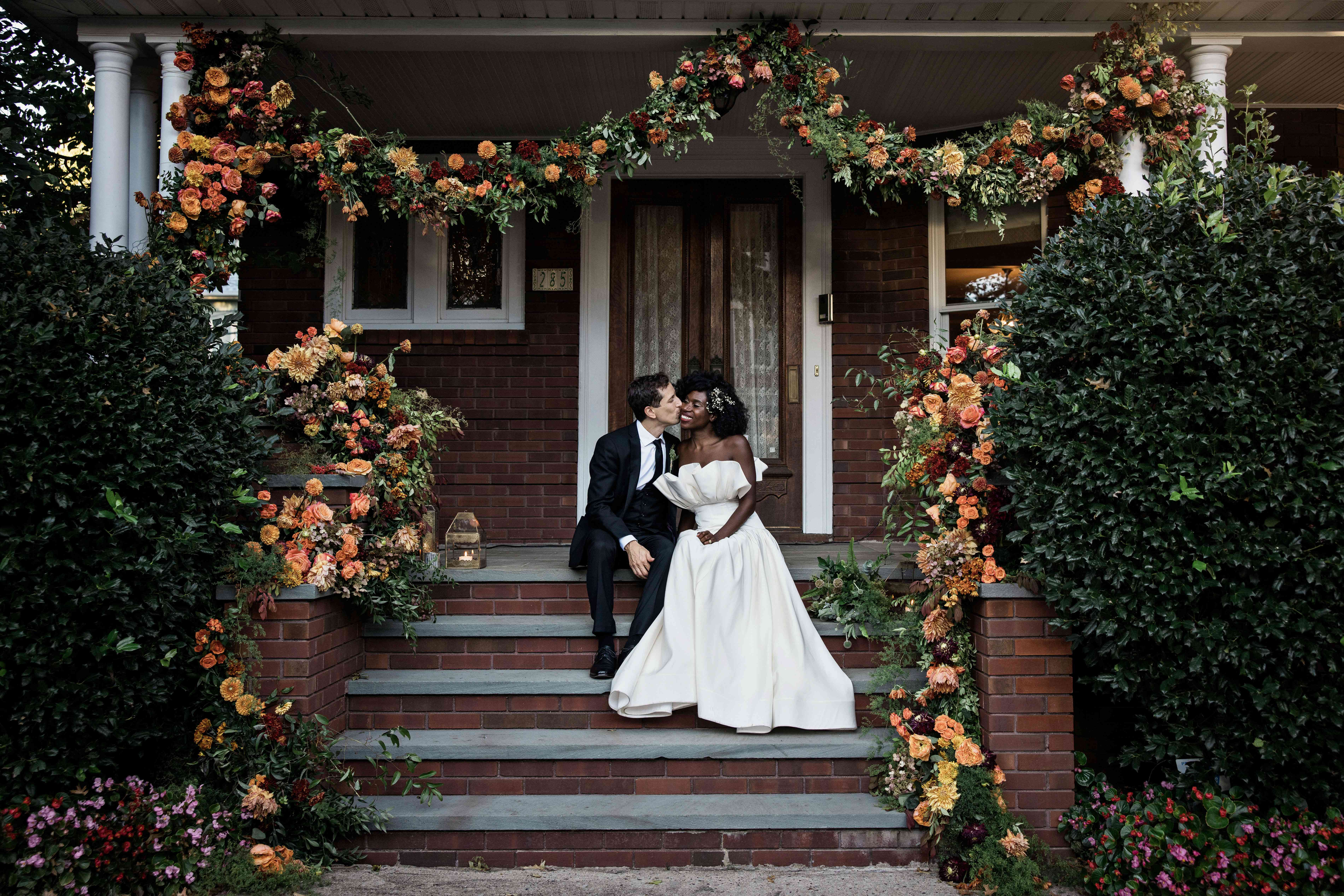 The couple under floral installation