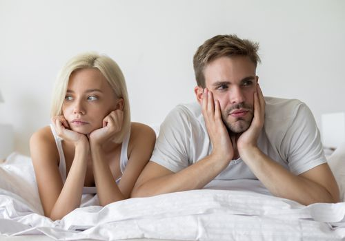 Man and Woman Upset in Bed