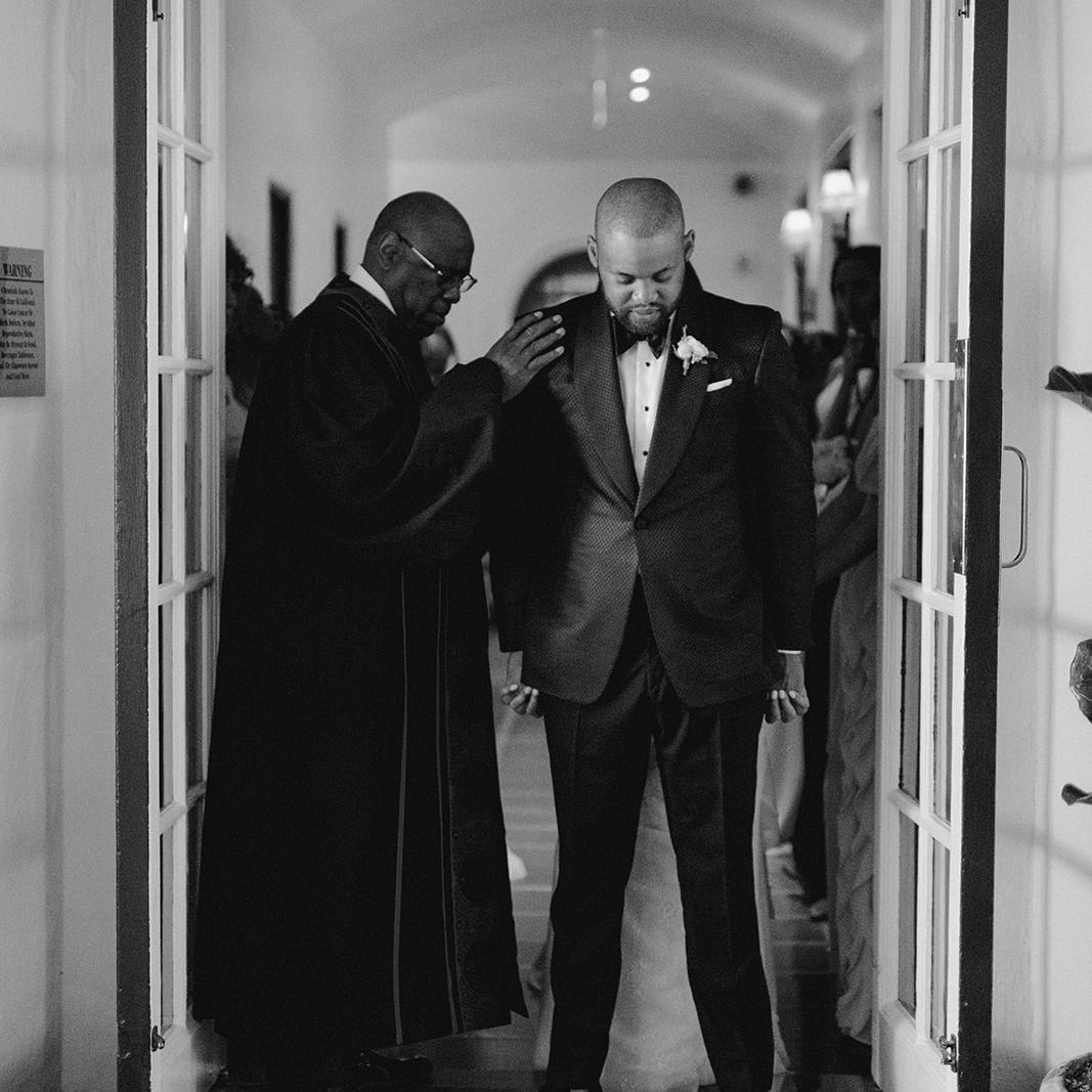 bride and groom saying a prayer