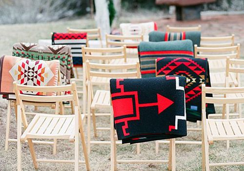 <p>Blankets Draped on Ceremony Chairs</p>