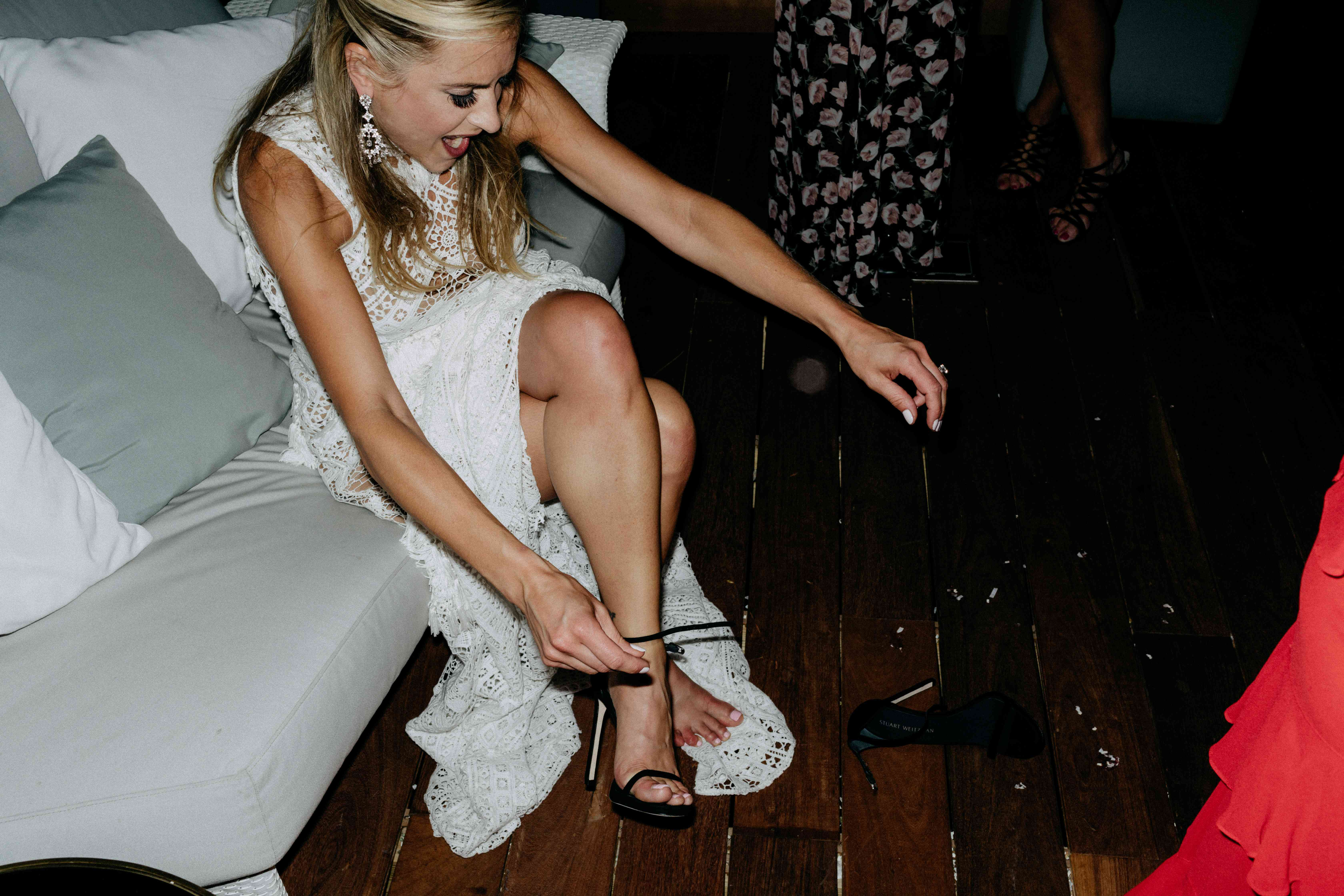 Bride taking off her shoes