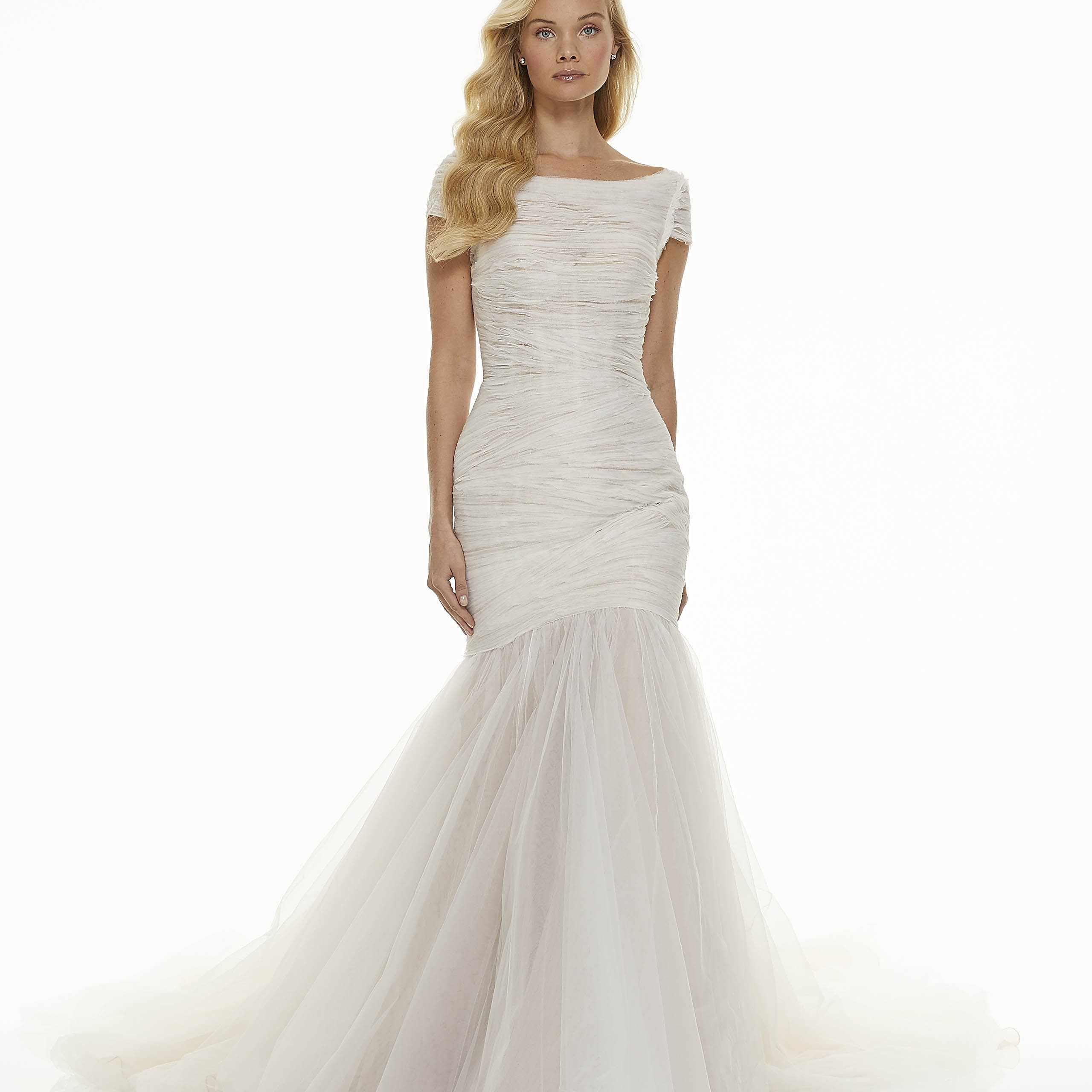 Model in bateau neckline mermaid wedding dress
