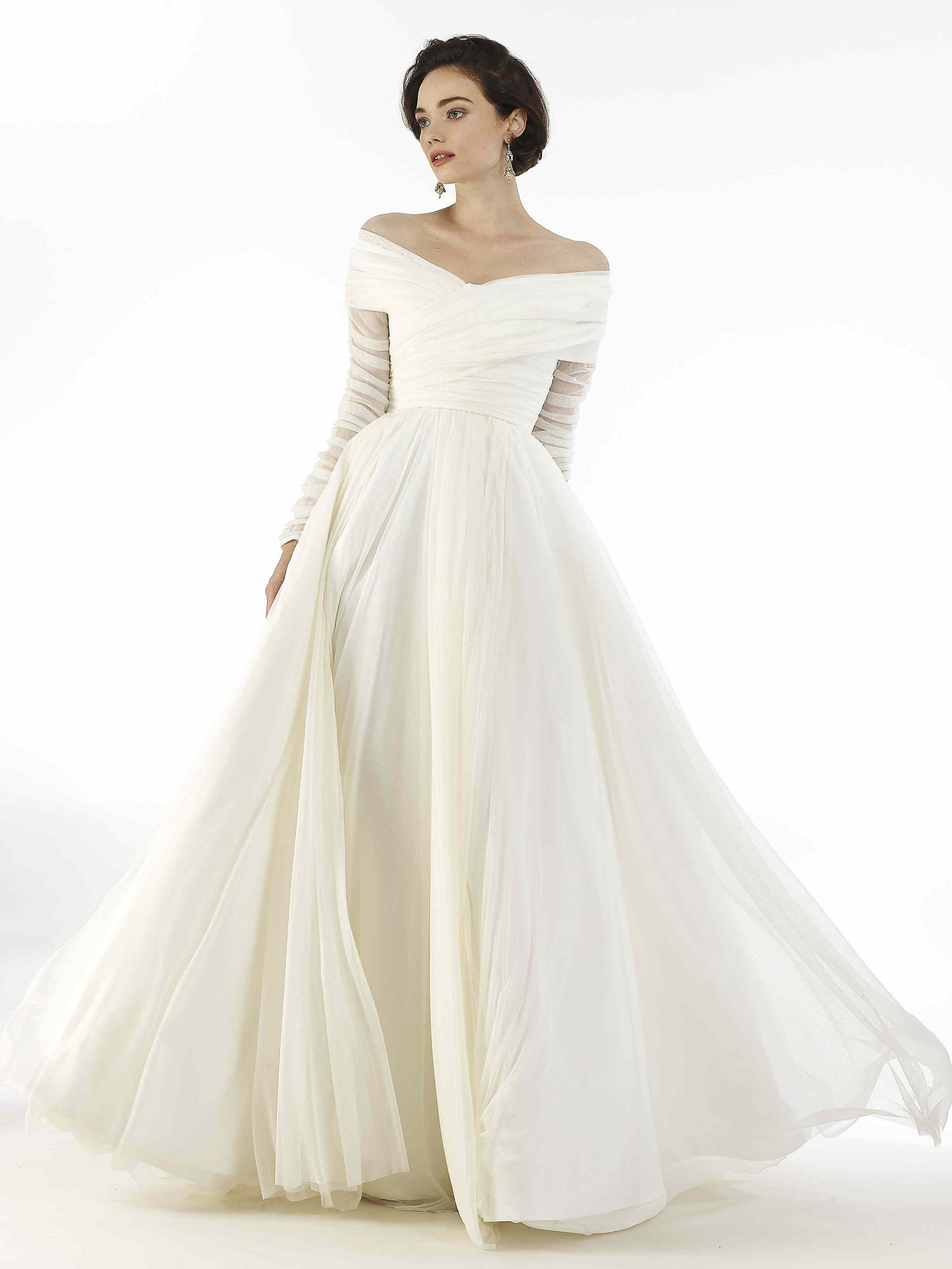 Model in long-sleeve off-the-shoulder pleated tulle ballgown