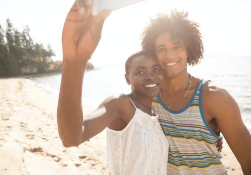 Couple on a beach taking a selfie