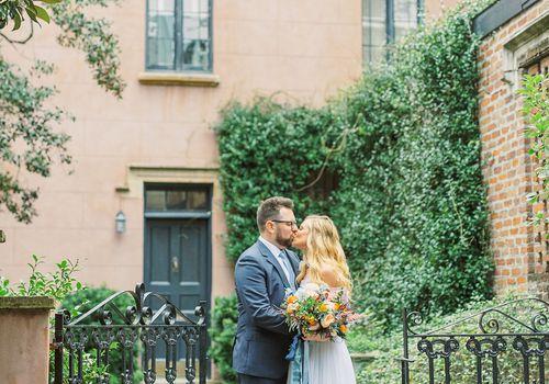 whimsical savannah wedding, bride and groom kissing