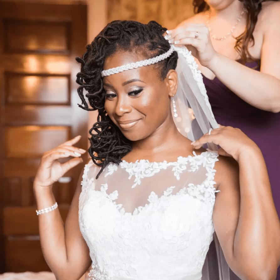 Bride with locs getting ready on wedding day