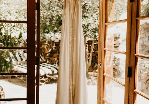 <p>wedding dress hanging</p>