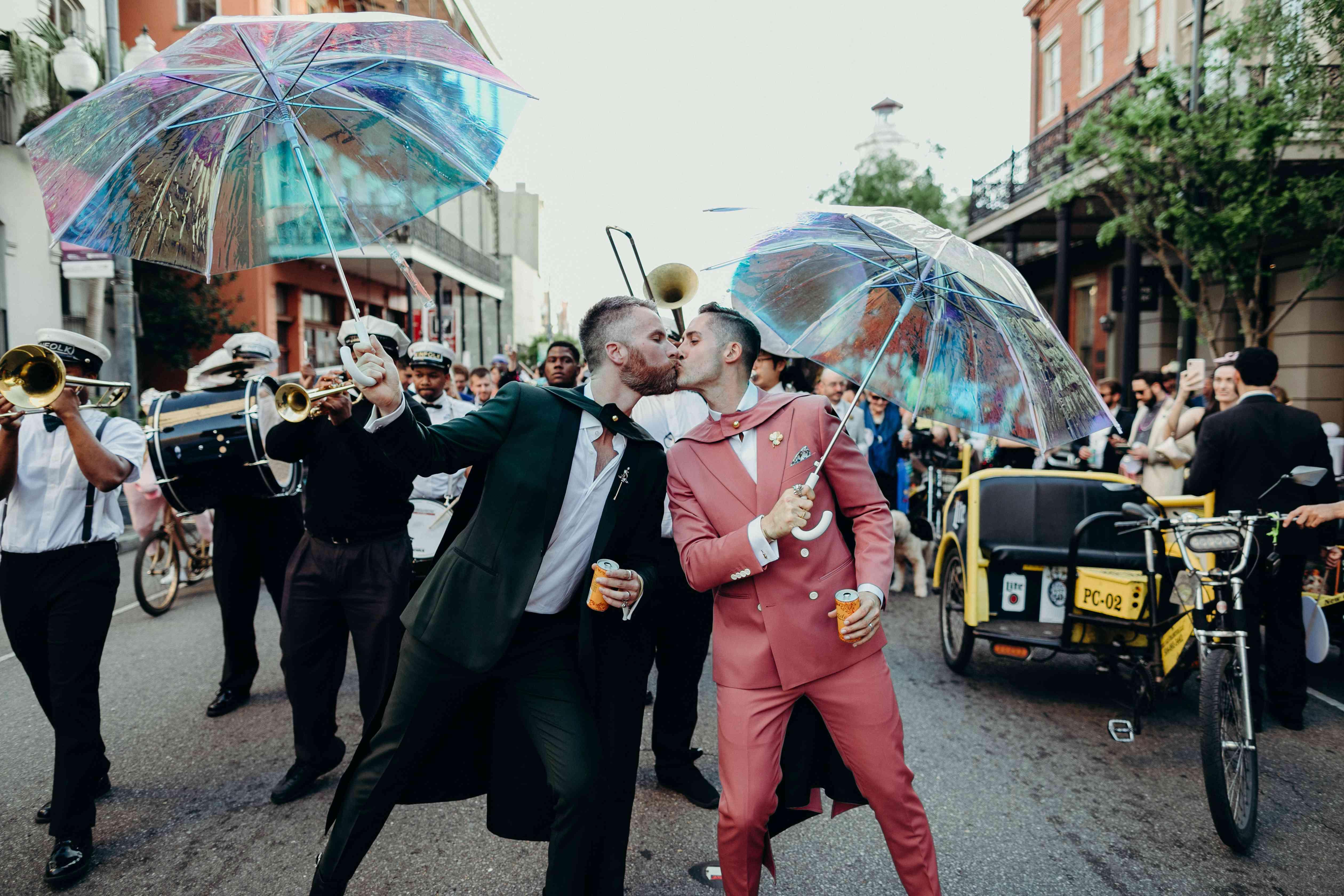 gay couple kissing during second parade at wedding