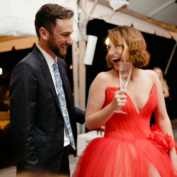 Newlywed bride and groom, bride in a red dress
