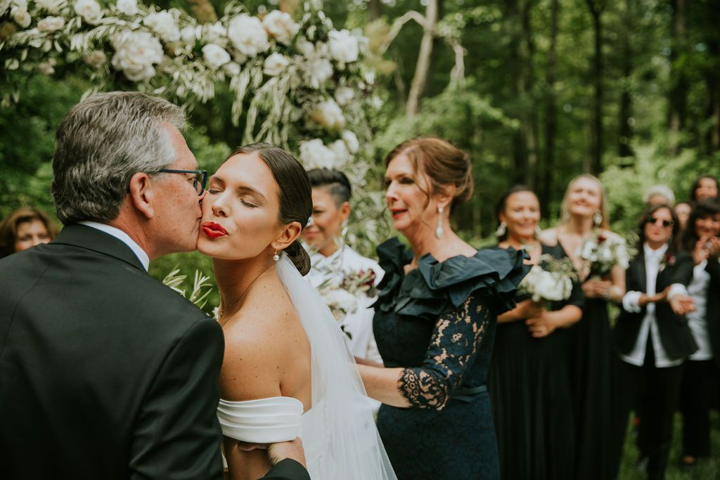 Meaghan gives her dad a kiss at the altar