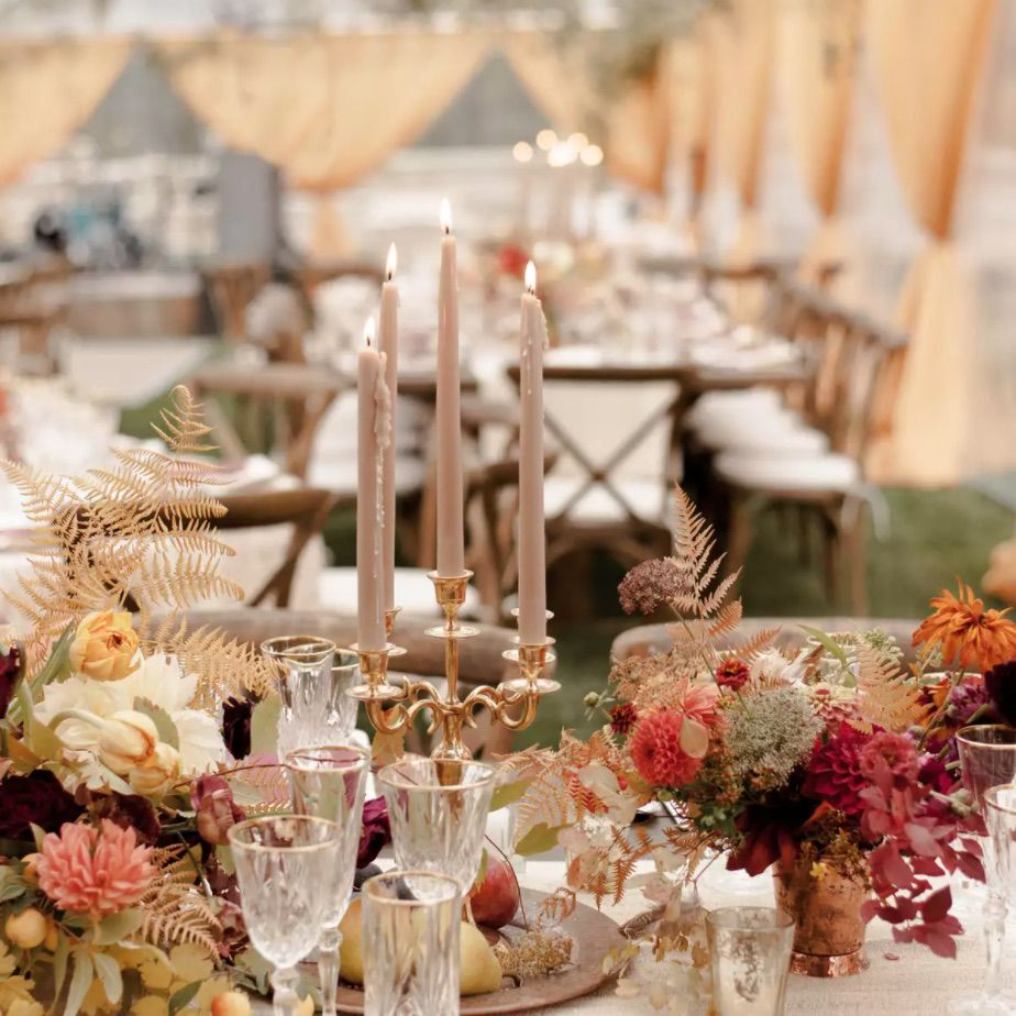 Autumnal tablescape with copper charger plates and harvest hued florals