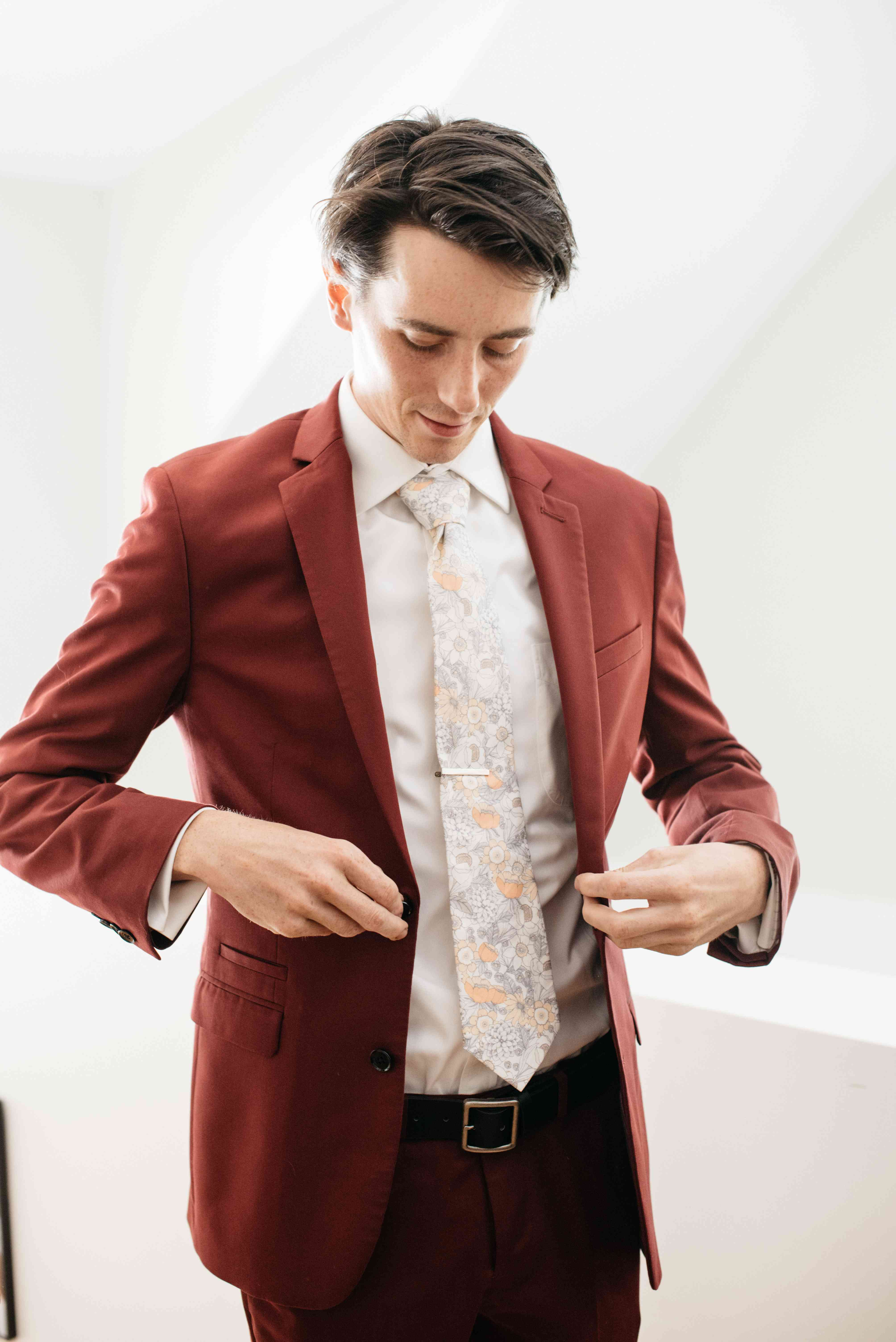 Groom in a red suit