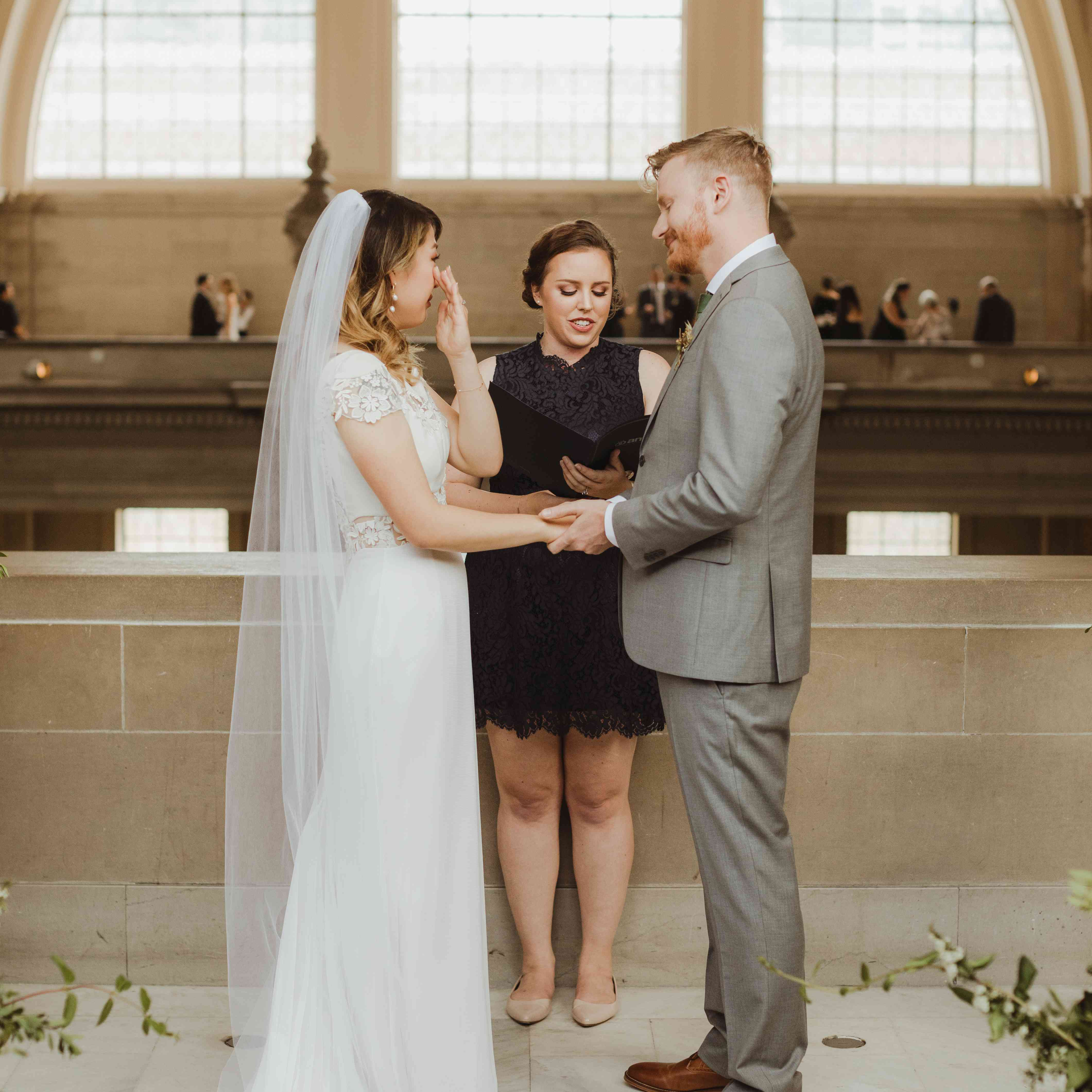 <p>Bride and groom crying</p><br><br>