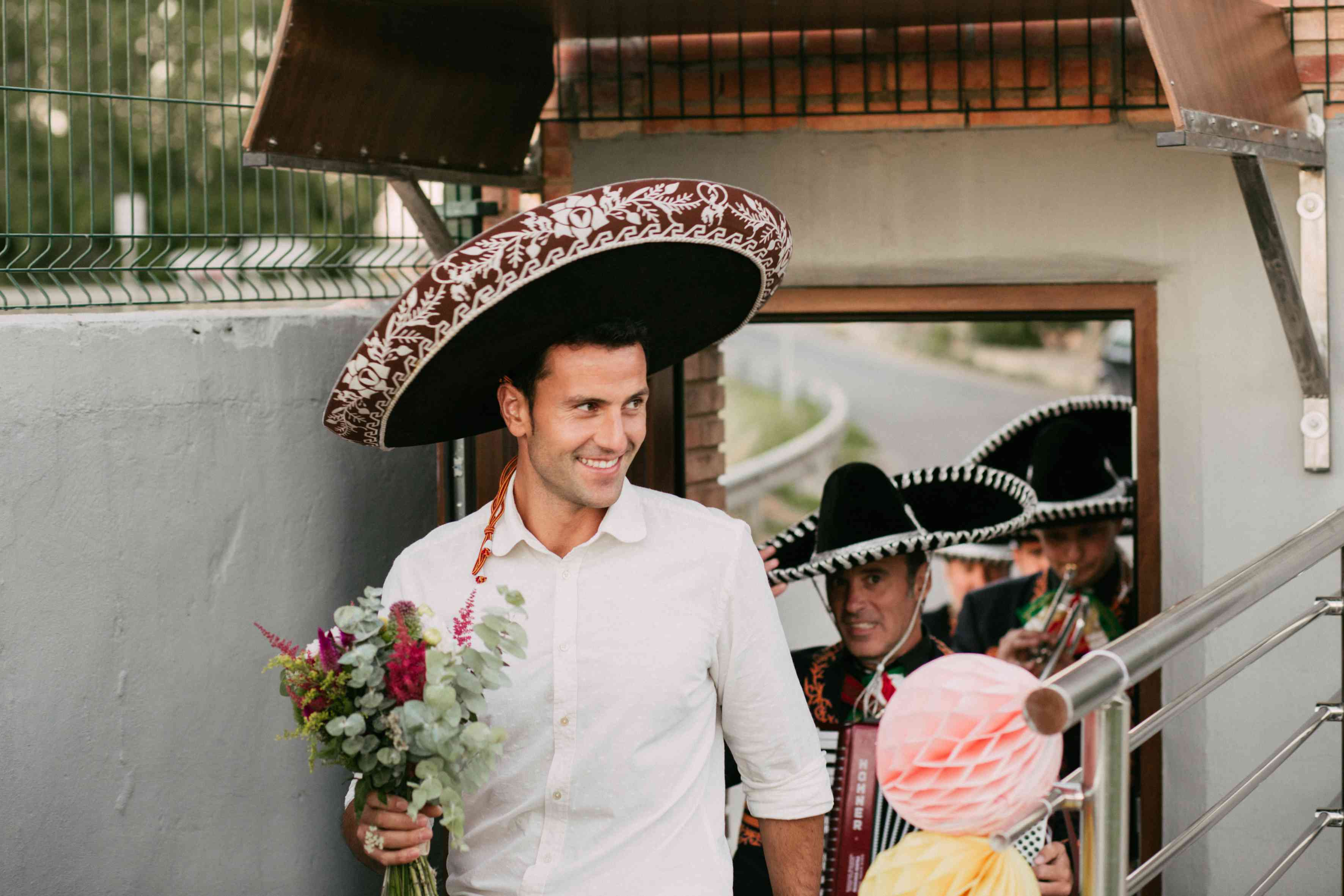 Groom in mariachi hat
