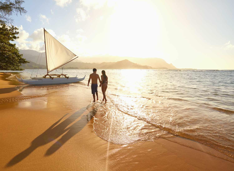 Couple walking on the beach in Hawaii