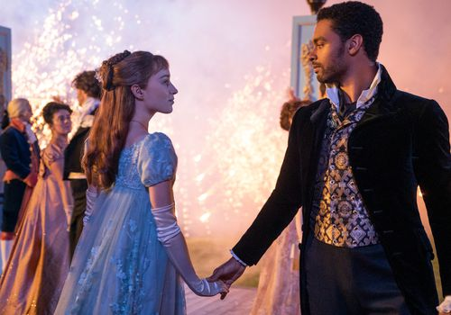 Daphne Bridgerton and Simon hold hands in front of a gorgeous fireworks disaply