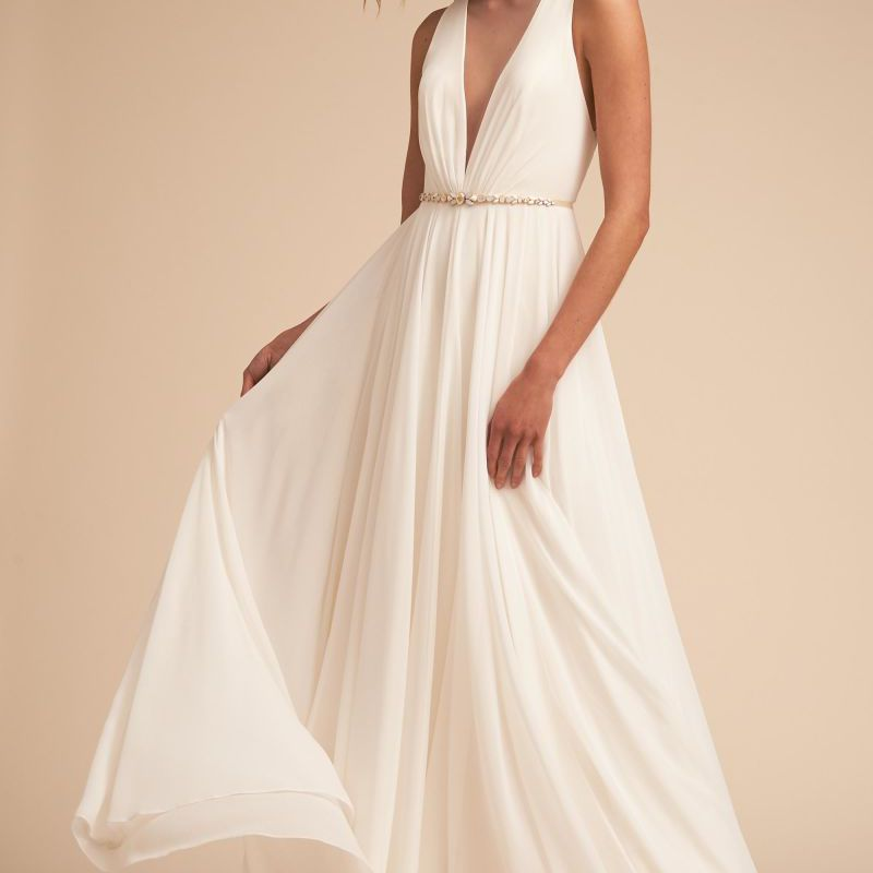Model in deep V illusion neckline wedding dress