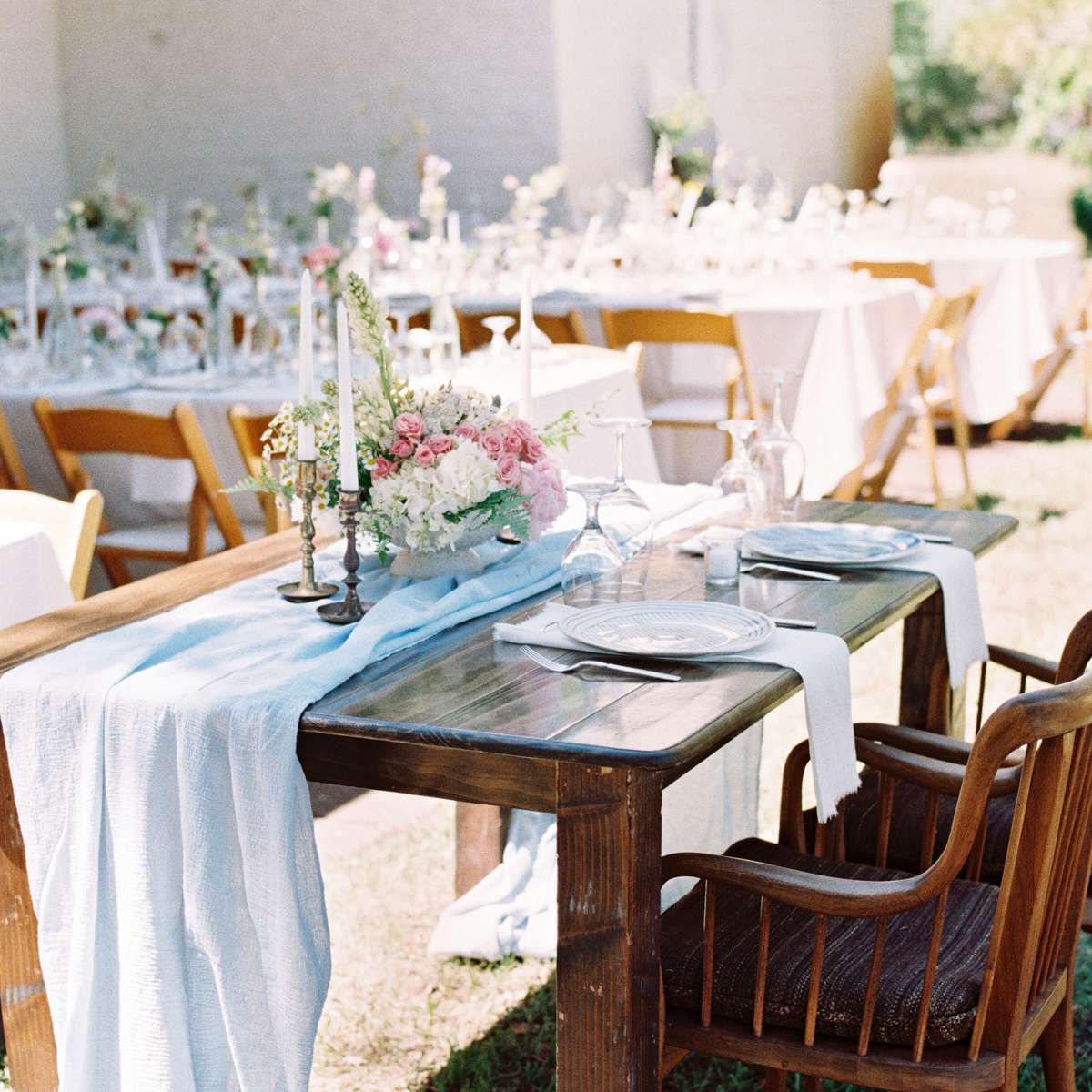 Bare wooden sweetheart table with antique accents