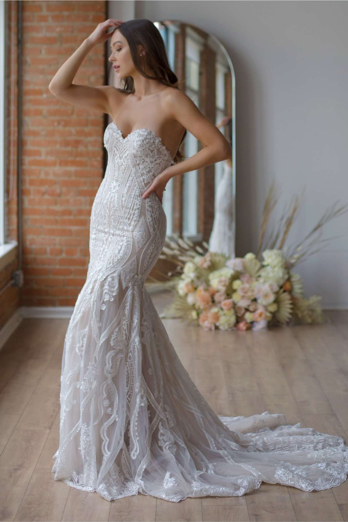 Model in strapless sweetheart lace fit-and-flare gown