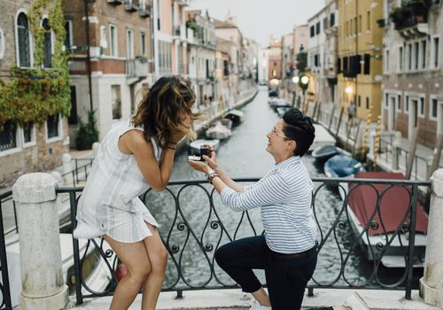 Woman proposing on one knee