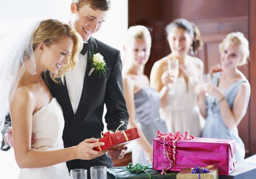 Bride and groom opening gift