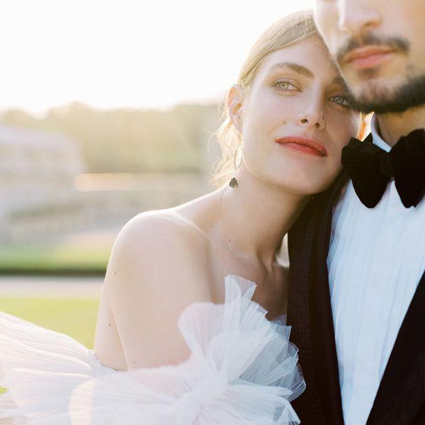 Glowing bride embracing groom