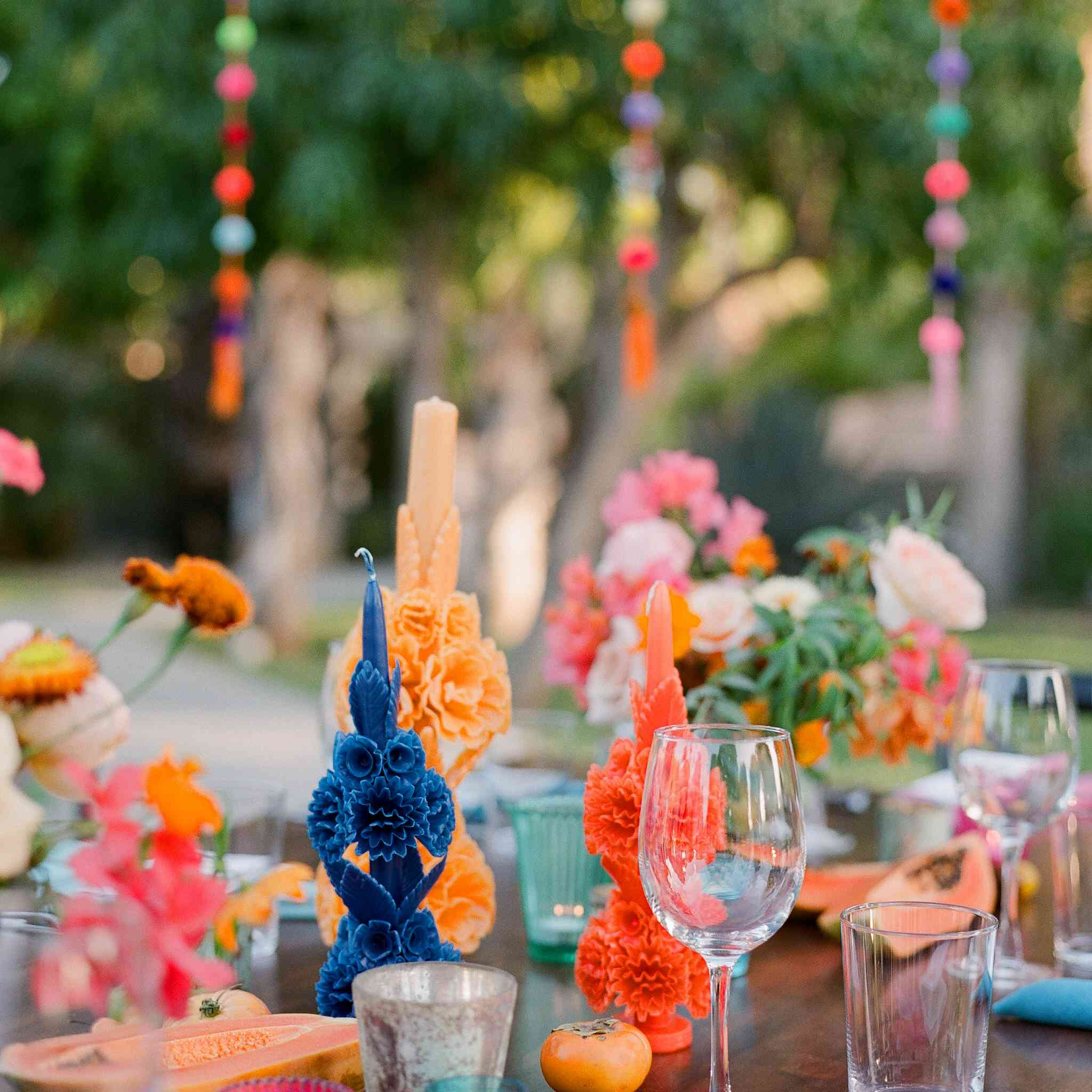 Colorful decorative candles on a set table at a wedding reception