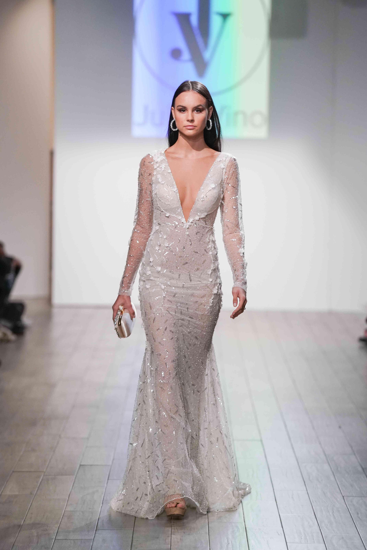 Model in long sleeve crystal embellished wedding dress