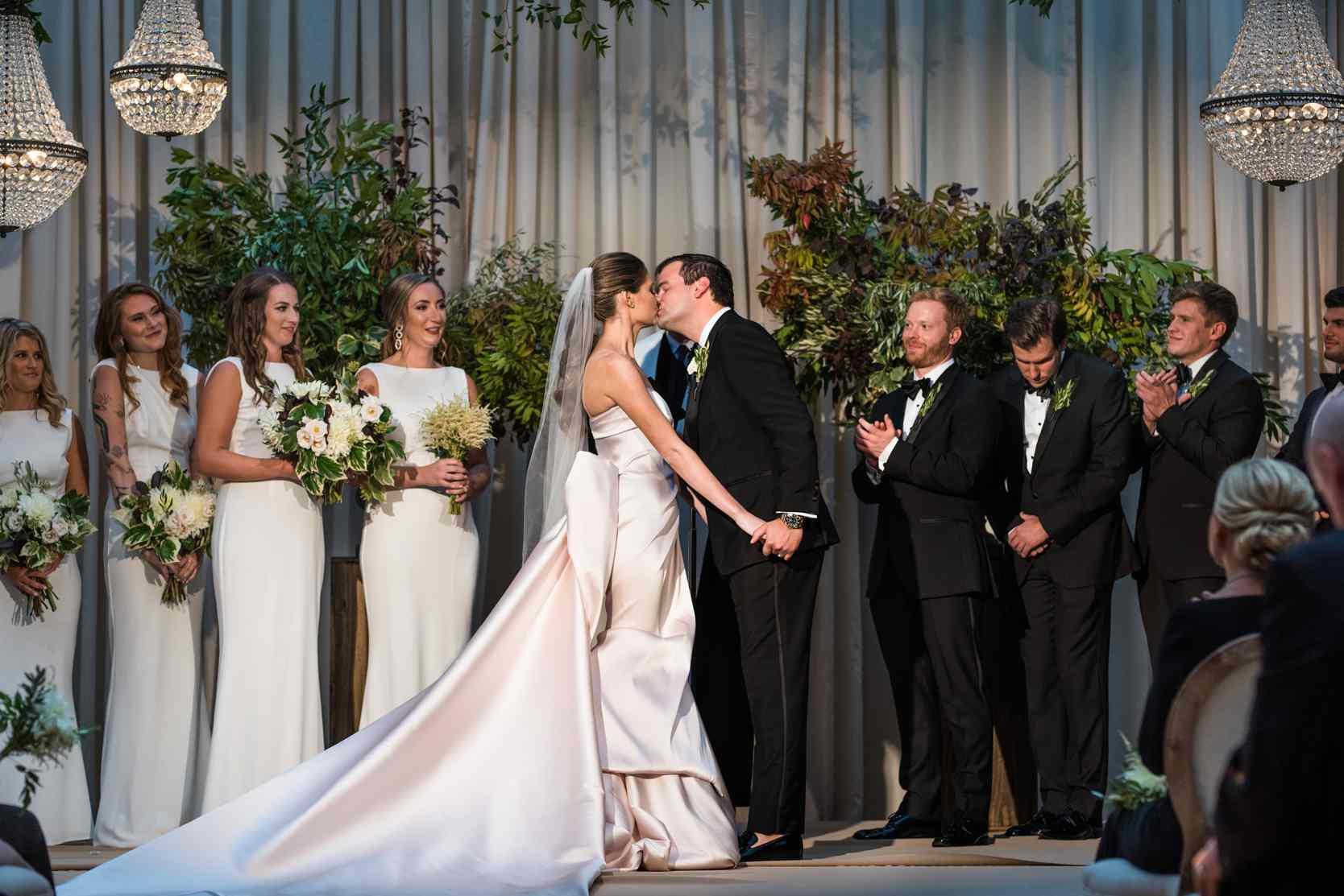 The newlyweds share a kiss