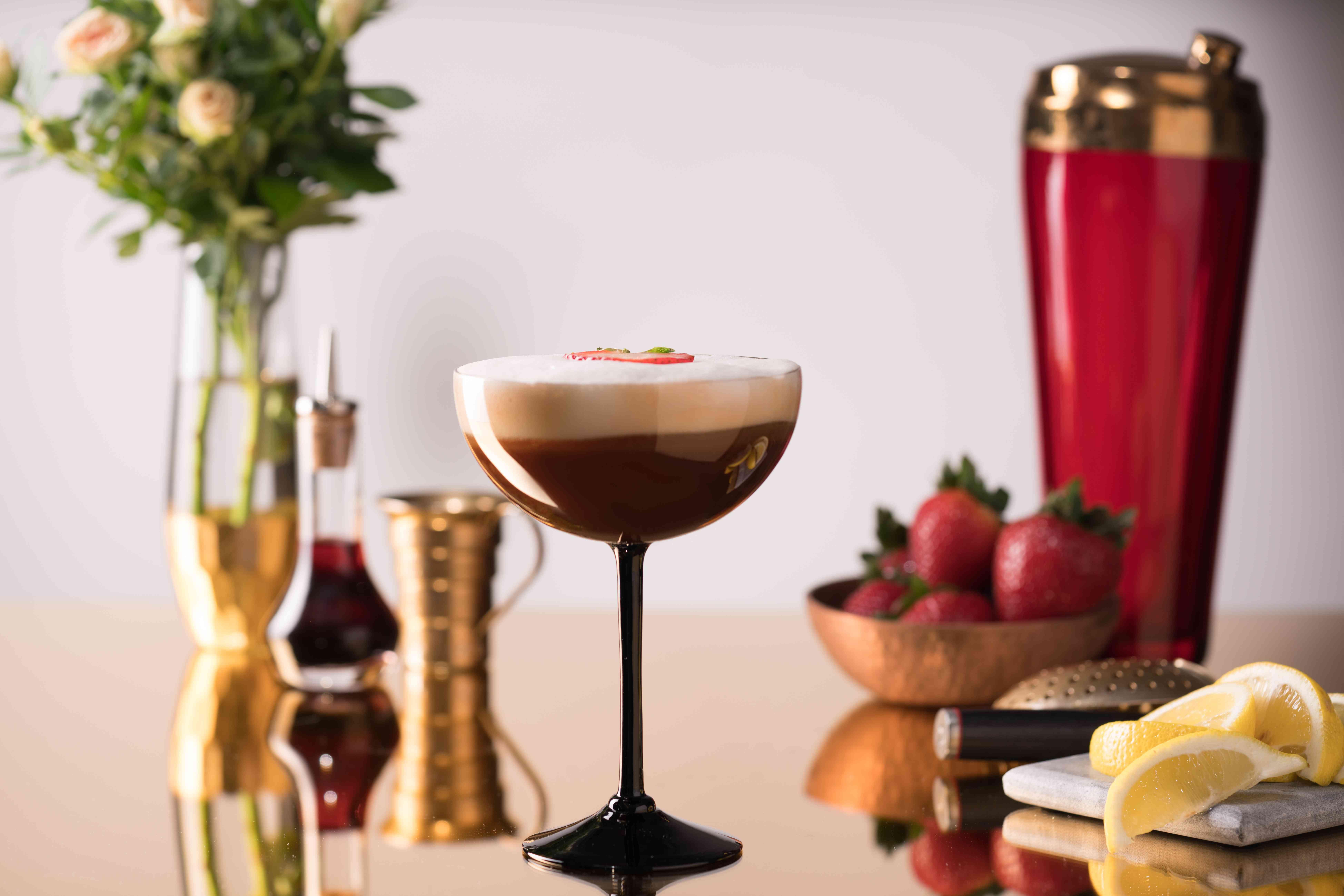 alcohol, signature cocktails, drink, glass, scotch, mezcal, citrus, lemon, strawberries, coupe, garnish