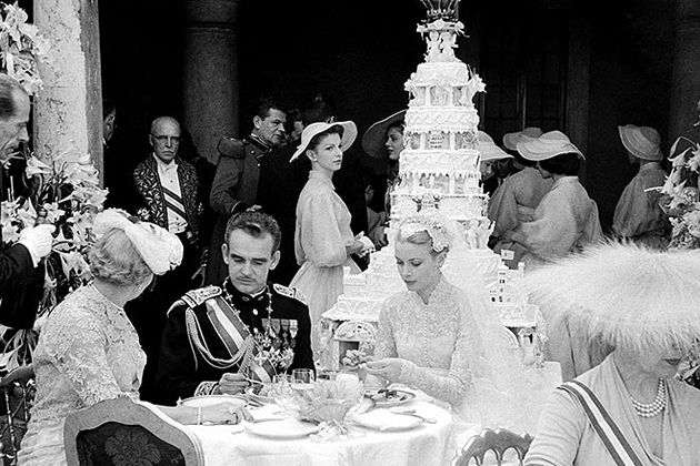 Grace Kelly and Prince Rainier at their wedding reception with cake in background