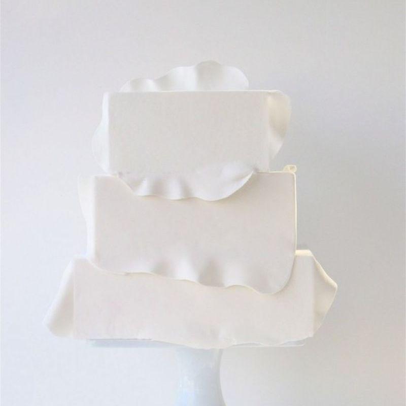 Ruffled square wedding cake