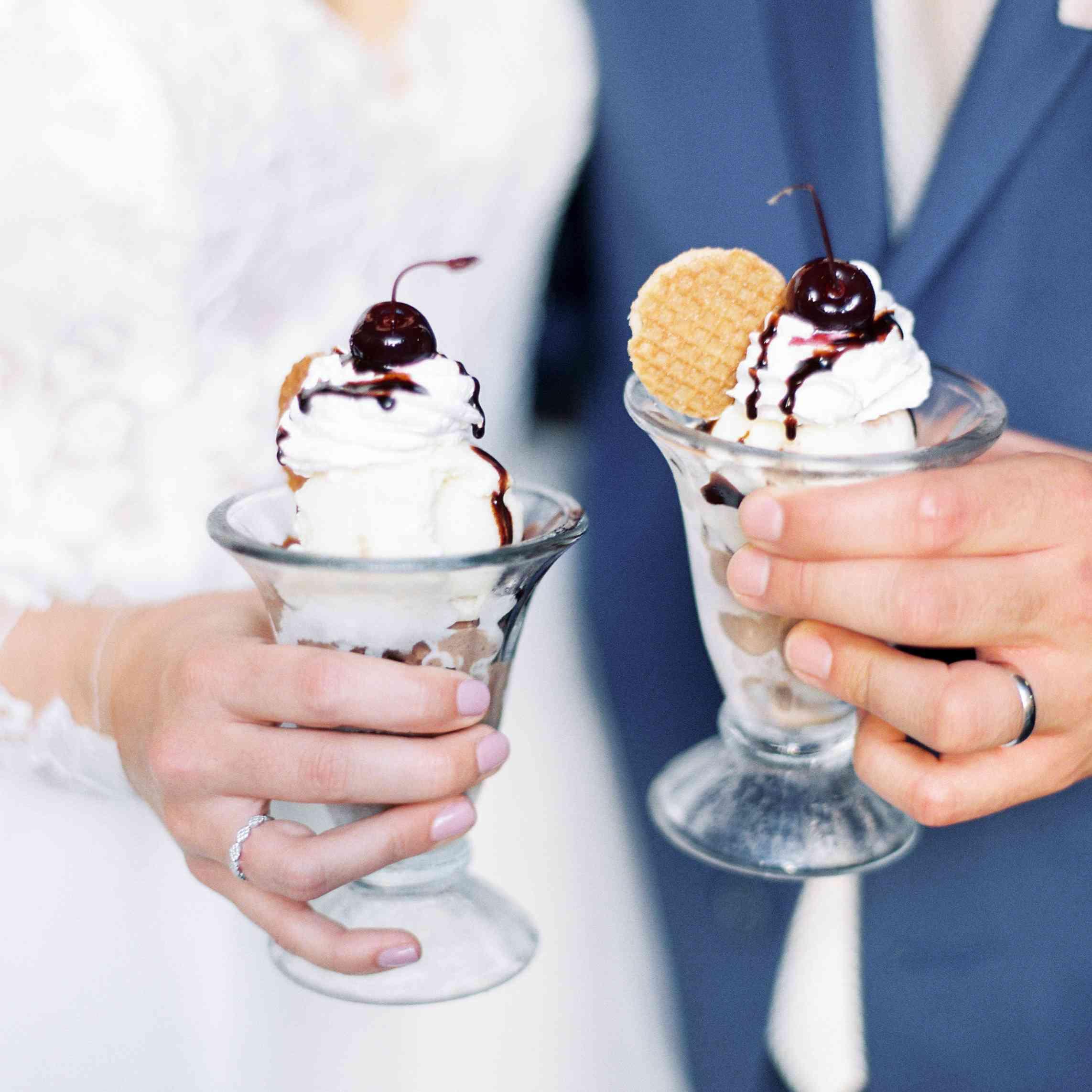 Couple holding ice cream sundaes