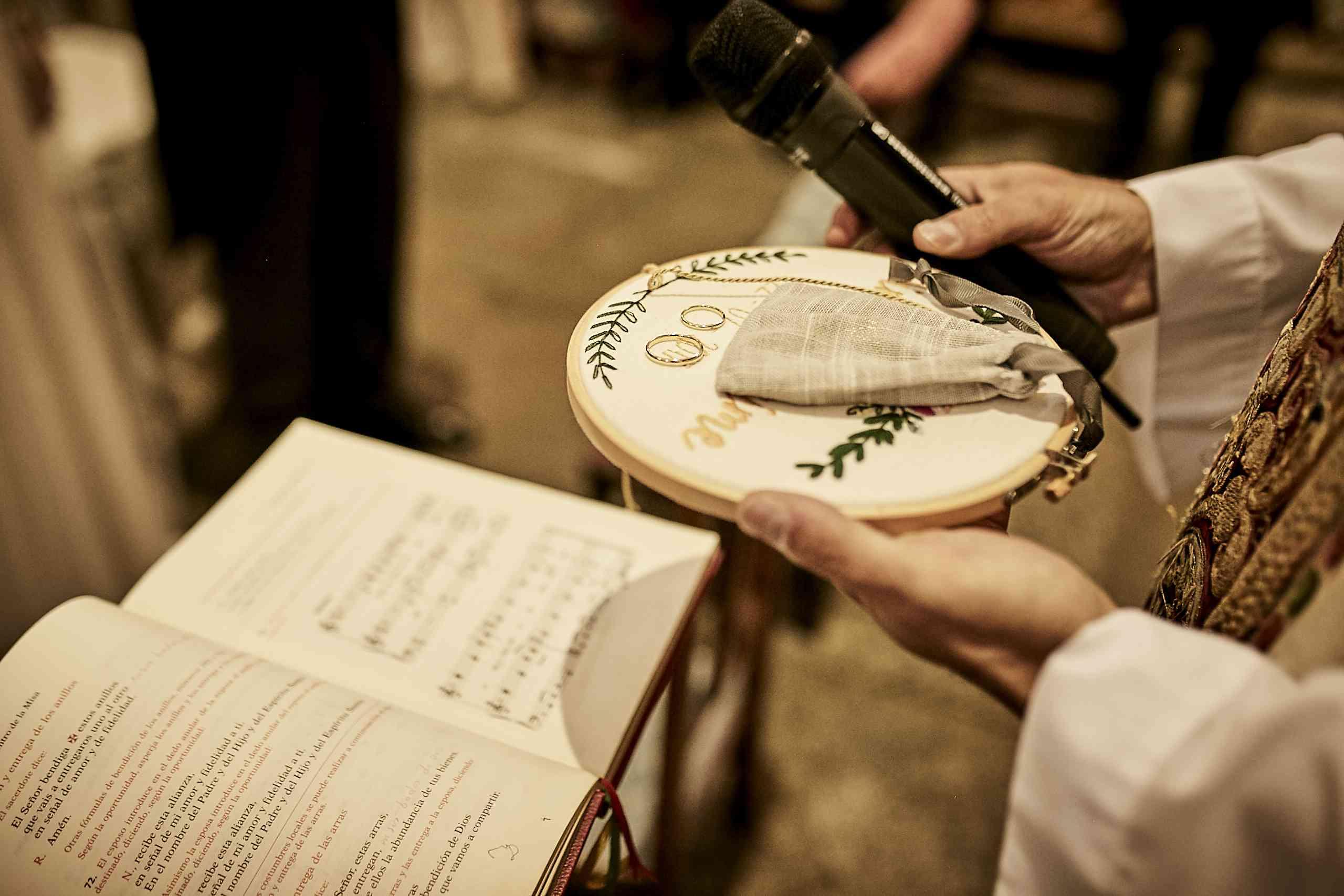 Catholic priest blessing rings
