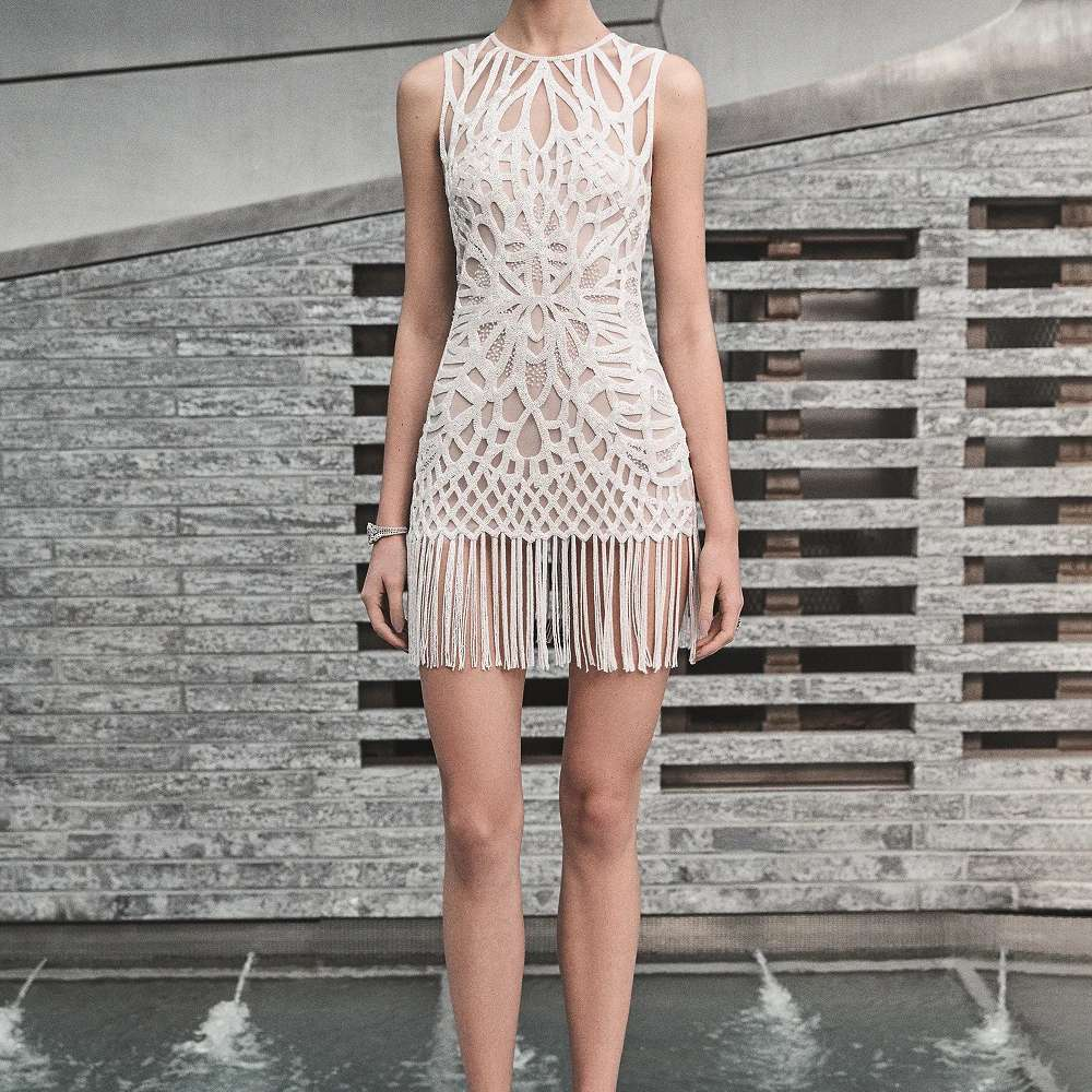 Model in sequined fringe short dress