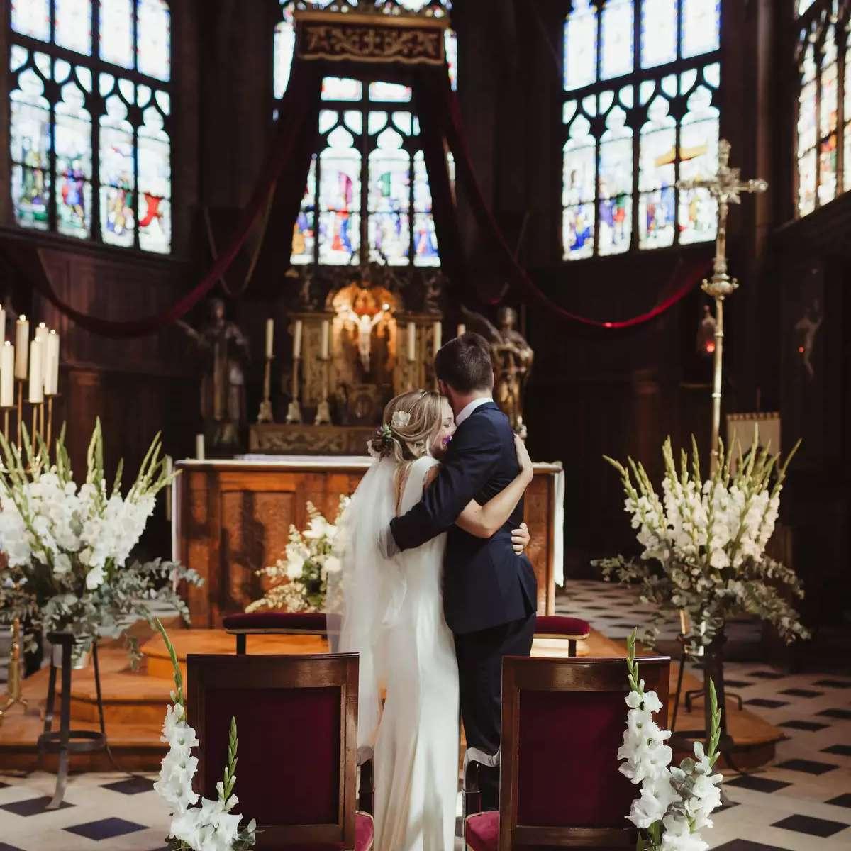Church wedding with long stem flowers