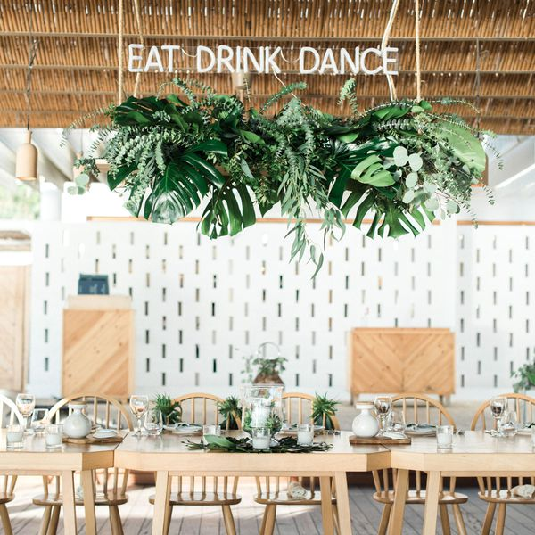 Hanging greenery installation at a wedding with