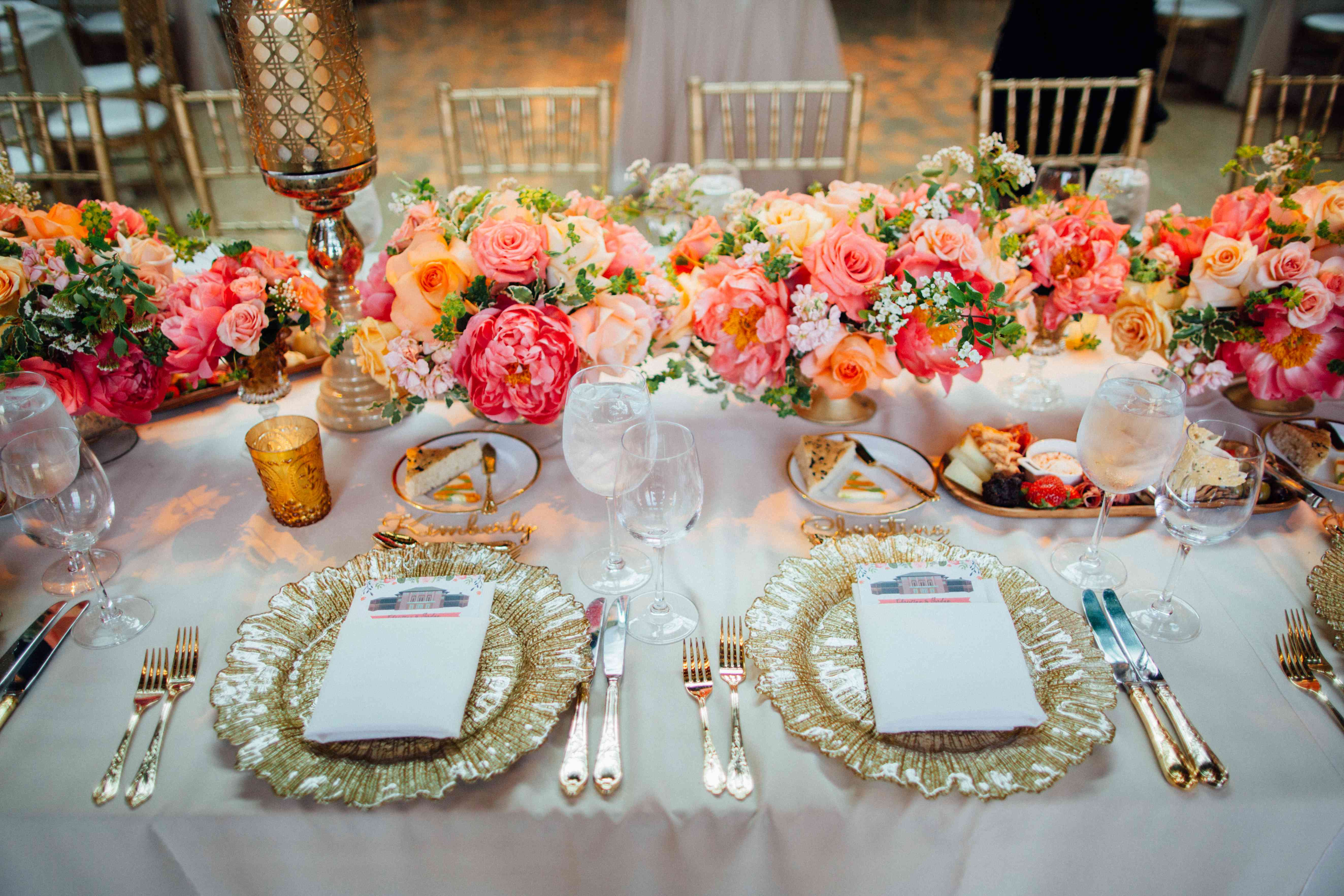 <p>Table Setting with Gold Plates and Pink Flowers</p><br><br>