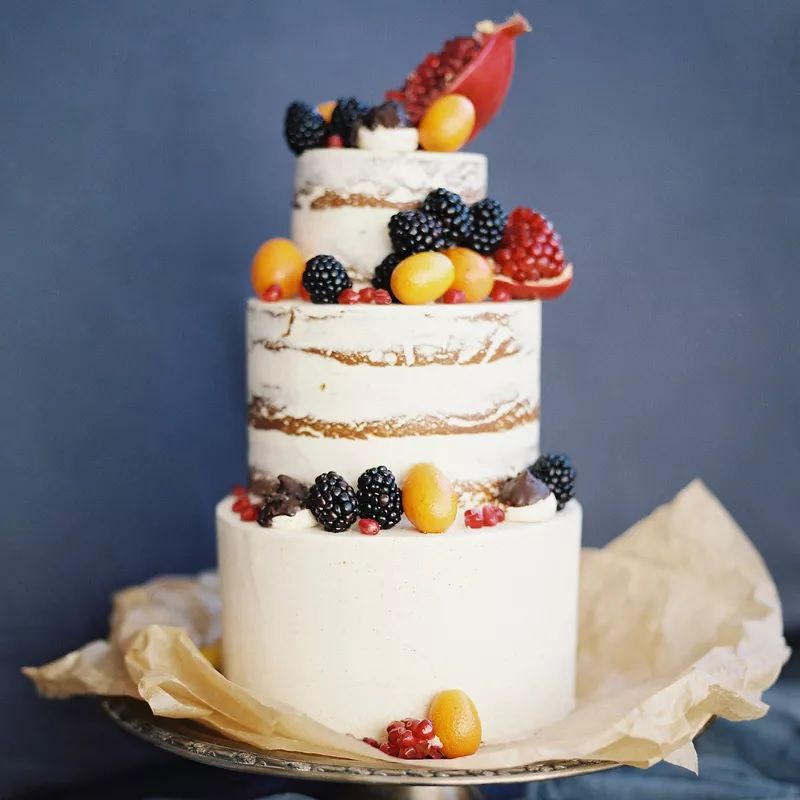 Naked wedding cake with summer berries