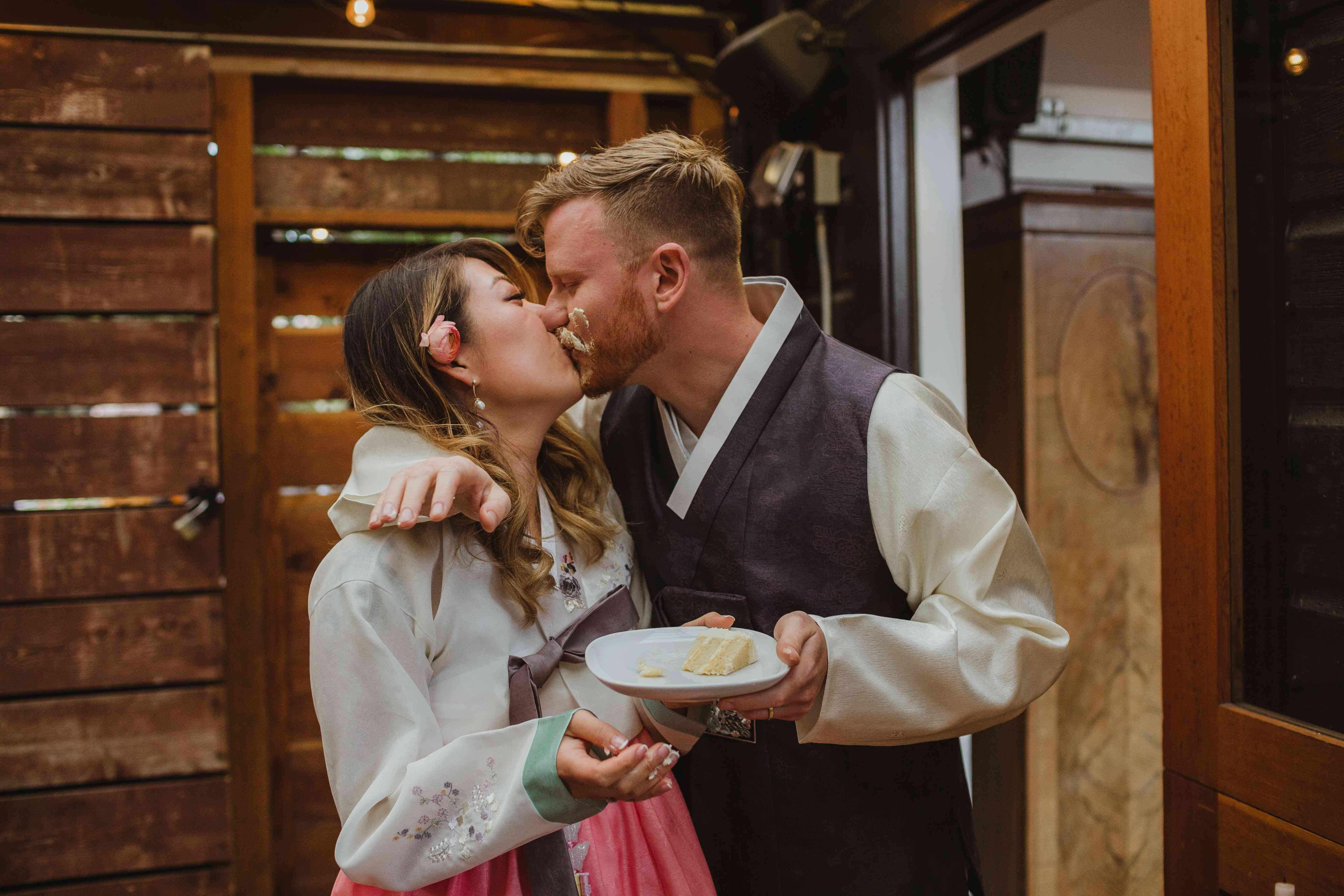 <p>Bride and groom kissing with cake</p><br><br>