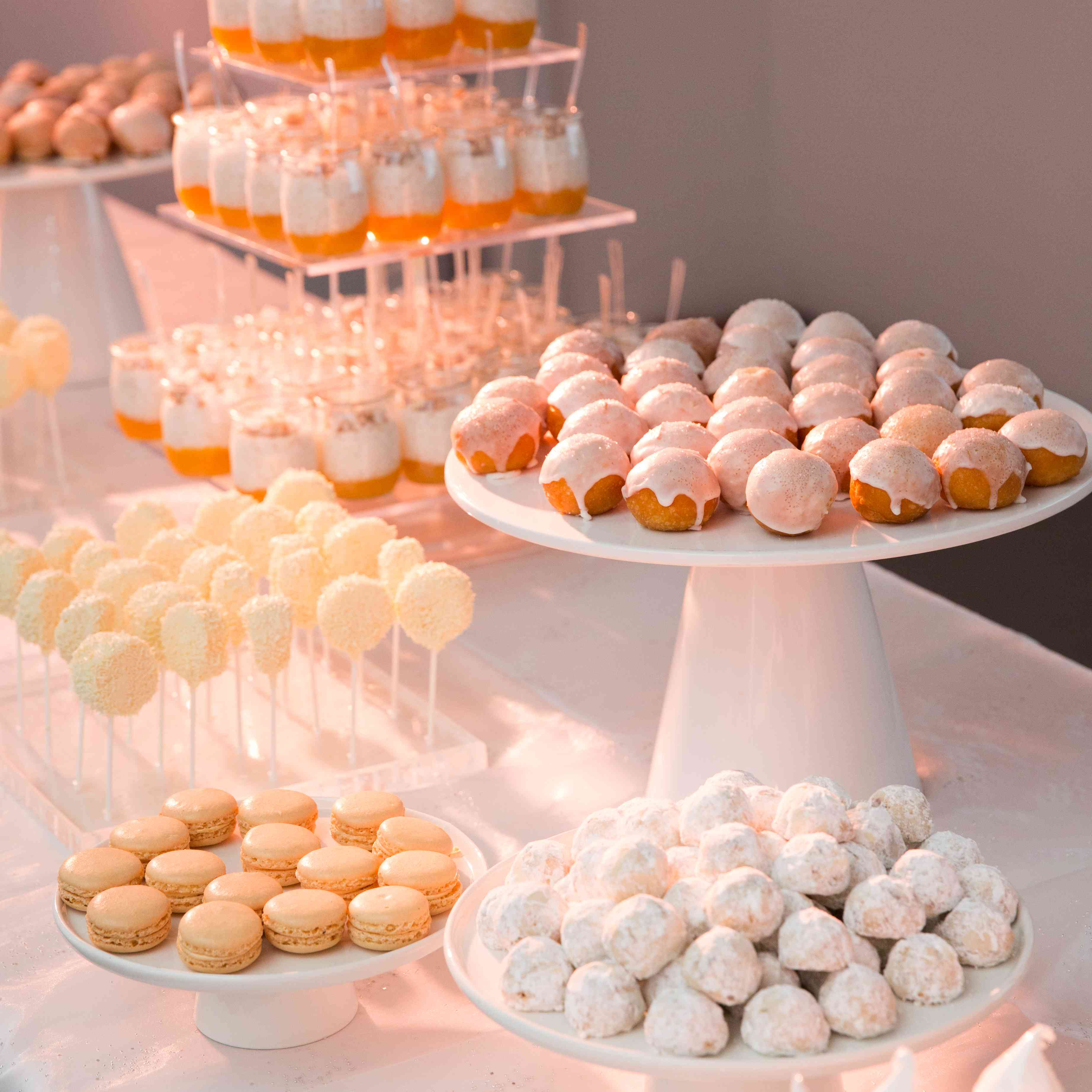 dessert bar with macaroons, cookies and donut holes