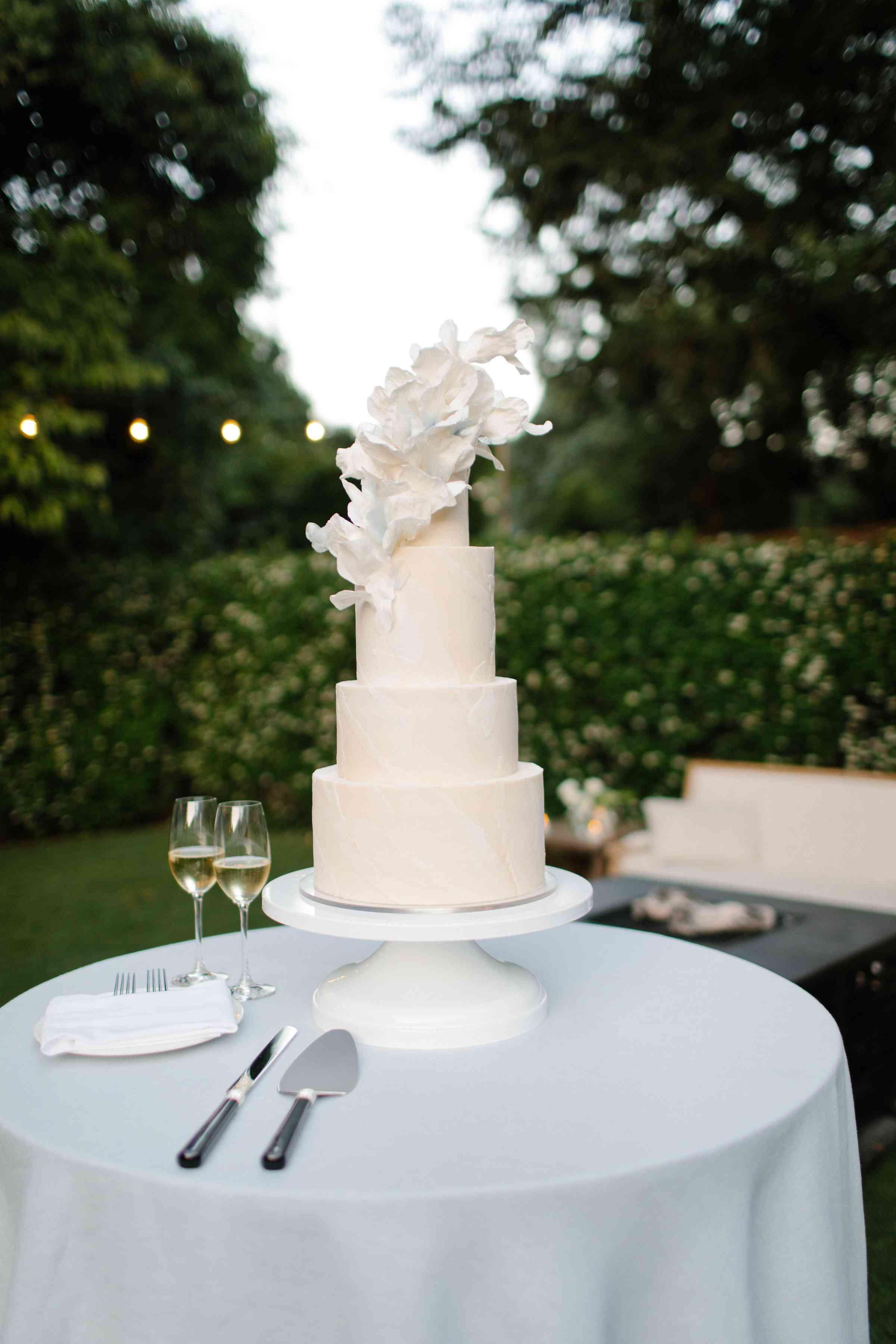 <p>four-tier white wedding cake</p><br><br>
